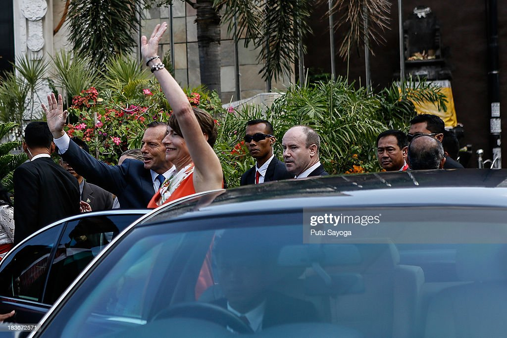 Australian Prime Minister Tony Abbott and his wife, Margaret Abbott wave hands before leaving Bali bombing memorial site on October 9, 2013 in Kuta, Indonesia. Mr Abbott has announced the Victims of Overseas Terrorism Compensation Scheme will now include attacks dating back to September 10, 2001.