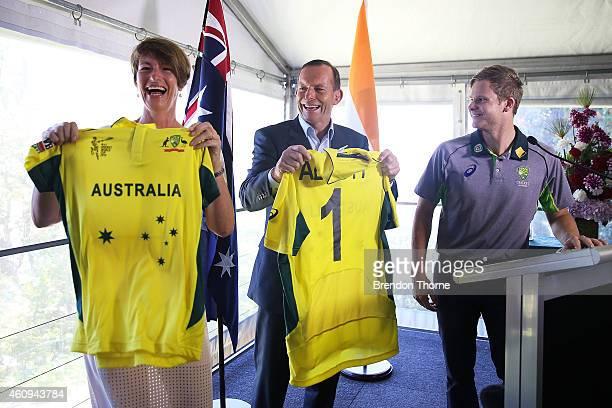 Australian Prime Minister Tony Abbott and his wife Margaret Abbott hold up personalised Australian One Day jerseys given by Australian captain Steve...