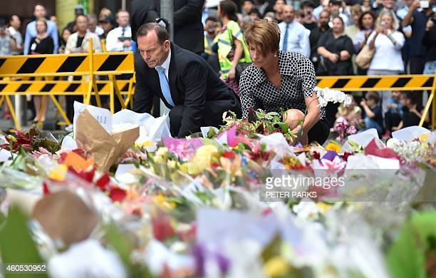 Australian Prime Minister Tony Abbott and his wife Margaret lay wreaths at a makeshift memorial near the scene of a fatal siege in the heart of...