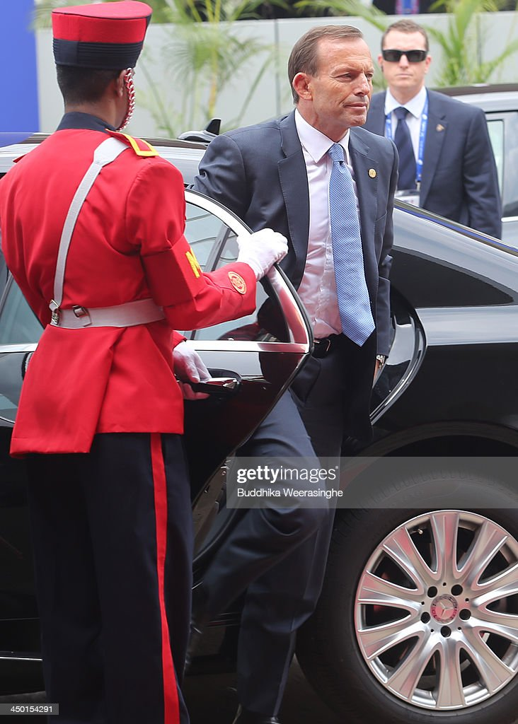 Australian Prime Minister <a gi-track='captionPersonalityLinkClicked' href=/galleries/search?phrase=Tony+Abbott&family=editorial&specificpeople=220956 ng-click='$event.stopPropagation()'>Tony Abbott</a> (C) arrives to Heads of State session on the final day of the Commonwealth Heads of Government Meeting (CHOGM) on November 17, 2013 in Colombo, Sri Lanka. The biennial summit of Commonwealth leaders was attended by over 5000 delegates including the Prince of Wales and the Duchess of Cornwall.