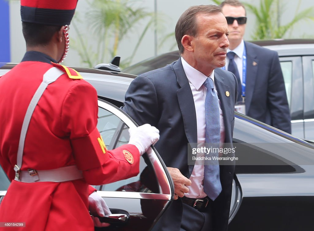 Australian Prime Minister Tony Abbott (C) arrives to Heads of State session on the final day of the Commonwealth Heads of Government Meeting (CHOGM) on November 17, 2013 in Colombo, Sri Lanka. The biennial summit of Commonwealth leaders was attended by over 5000 delegates including the Prince of Wales and the Duchess of Cornwall.