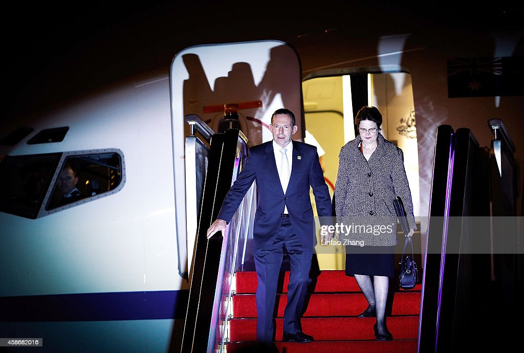 Australian Prime Minister <a gi-track='captionPersonalityLinkClicked' href=/galleries/search?phrase=Tony+Abbott&family=editorial&specificpeople=220956 ng-click='$event.stopPropagation()'>Tony Abbott</a> arrives with the ambassador to China, Frances Adamson at the Beijing Capital International Airport on November 9, 2014 in Beijing, China. From November 7-11, the APEC 2014 Summit will bring together leaders and senior administration from 21 countries, with U.S. President Barack Obama and Russian President Vladimir Putin expected to attend.