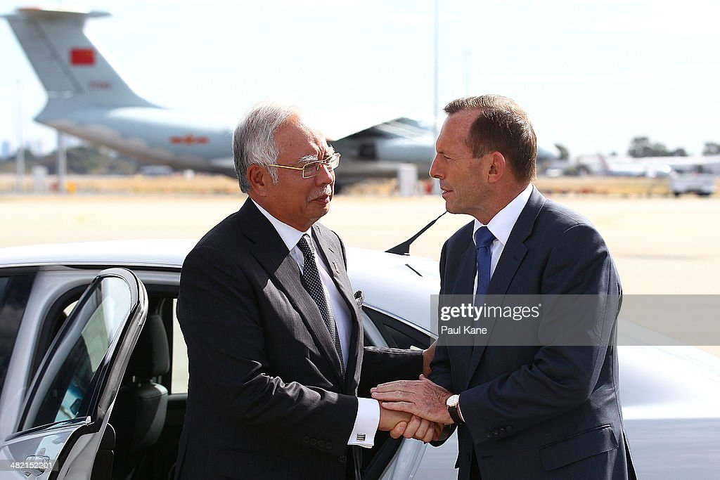 Australian Prime Minister <a gi-track='captionPersonalityLinkClicked' href=/galleries/search?phrase=Tony+Abbott&family=editorial&specificpeople=220956 ng-click='$event.stopPropagation()'>Tony Abbott</a> (R) bids farewell to Malaysian Prime Minister Najib Razak after his visit to Perth during the search of missing Malaysia Airlines flight MH370 at Perth International airport on April 3, 2014 in Perth, Australia. The search continues off the Western Australian coast for Malaysia Airlines flight MH370 that vanished on March 8 with 239 passengers and crew on board. The flight is suspected to have crashed into the southern Indian Ocean with no survivors.
