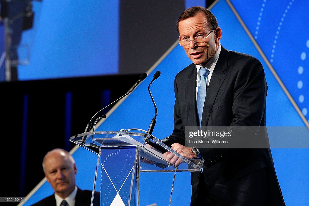 Australian Prime Minister <a gi-track='captionPersonalityLinkClicked' href=/galleries/search?phrase=Tony+Abbott&family=editorial&specificpeople=220956 ng-click='$event.stopPropagation()'>Tony Abbott</a> delivers his keynote speech during the B20 Summit on July 17, 2014 in Sydney, Australia. Over 350 business leaders have gathered in Sydney for the 2014 B20 Summit to discuss and determine policy recommendations ahead of the G20 Leaders Meeting in Brisbane later this year.