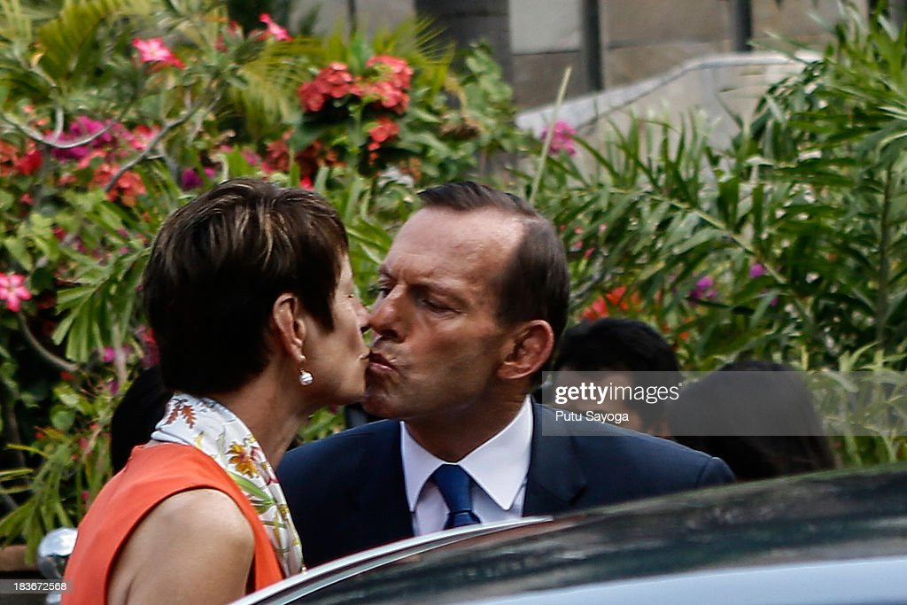 Australian Prime Minister <a gi-track='captionPersonalityLinkClicked' href=/galleries/search?phrase=Tony+Abbott&family=editorial&specificpeople=220956 ng-click='$event.stopPropagation()'>Tony Abbott</a> kisses his wife Maggie Abbott at the Bali bombing memorial site on October 9, 2013 in Kuta, Indonesia. Mr Abbott has announced the Victims of Overseas Terrorism Compensation Scheme will now include attacks dating back to September 10, 2001.