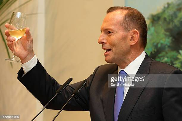 Australian Prime Minister Tony Abbott makes a toast during an official lunch hosted by Singapore Prime Minister Lee Hsien Loong at the Istana on June...