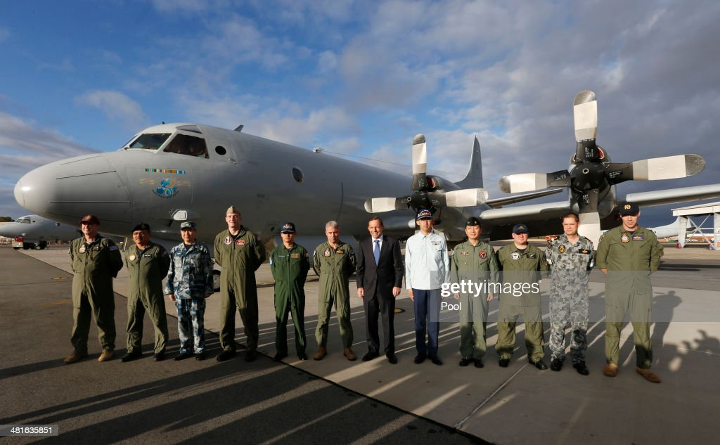 Australian Prime Minister Tony Abbott poses with leaders of international military operations currently based in Australia searching for Malaysia...