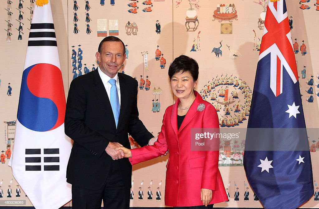 Australian Prime Minister Tony Abbott shakes hands with South Korean President Park Geun-Hye before their meeting at the presidential blue house on April 8, 2014 in Seoul, South Korea. This is a part of Tony Abbott's first official trip to north east Asia, making stops in Japan, South Korea, and China.