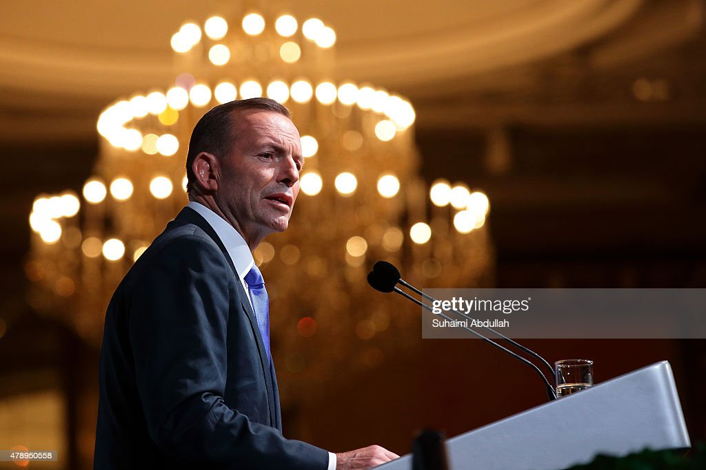 Australian Prime Minister <a gi-track='captionPersonalityLinkClicked' href=/galleries/search?phrase=Tony+Abbott&family=editorial&specificpeople=220956 ng-click='$event.stopPropagation()'>Tony Abbott</a> speaks during the 35th Singapore lecture at the Shangri-La Hotel on June 29, 2015 in Singapore. Australian Prime Minister <a gi-track='captionPersonalityLinkClicked' href=/galleries/search?phrase=Tony+Abbott&family=editorial&specificpeople=220956 ng-click='$event.stopPropagation()'>Tony Abbott</a> is on a two day official visit to Singapore to strengthen economic, defence and security ties.