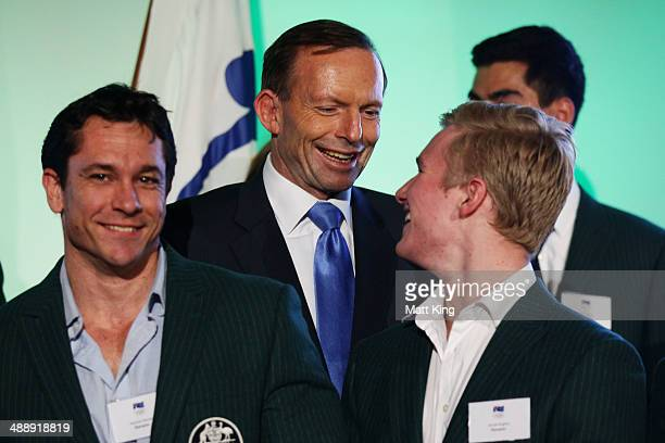 Australian Prime Minister Tony Abbott speaks to 2014 Sochi Australian Olympians Duncan Harvey and Jarryd Hughes during the Official Welcome Home...