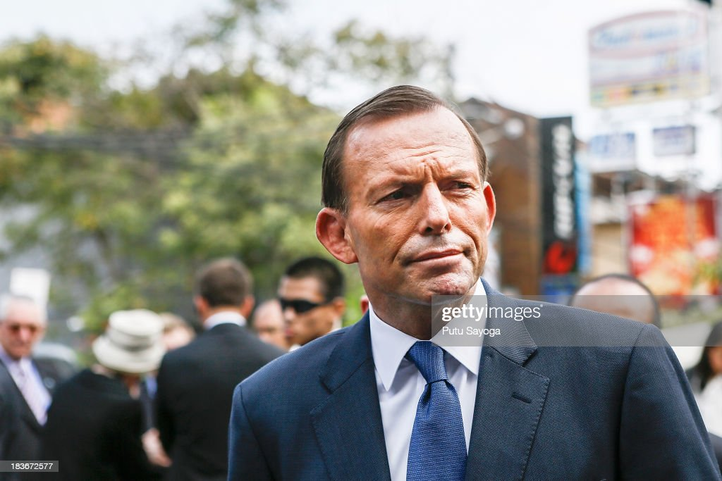 Australian Prime Minister <a gi-track='captionPersonalityLinkClicked' href=/galleries/search?phrase=Tony+Abbott&family=editorial&specificpeople=220956 ng-click='$event.stopPropagation()'>Tony Abbott</a> visits the Bali bombing memorial site on October 9, 2013 in Kuta, Indonesia. Mr Abbott has announced the Victims of Overseas Terrorism Compensation Scheme will now include attacks dating back to September 10, 2001.