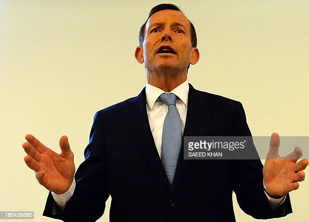 Australian Prime Ministerelect Tony Abbot speaks to newly elected members during their party meeting in Parliament House in Canberra on September 13...