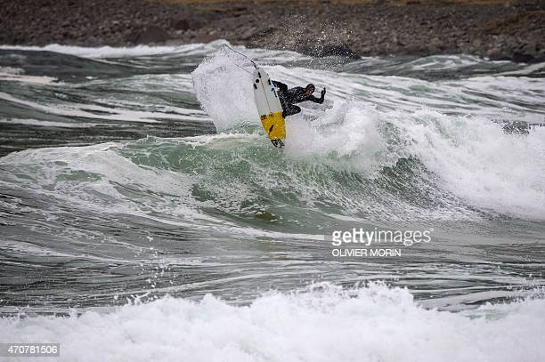 Australian professional surfer Micah Lester surfs in Unstad in the Lofoten Islands within the Arctic Circle on April 19 2015 Surfing in the Lofoten...