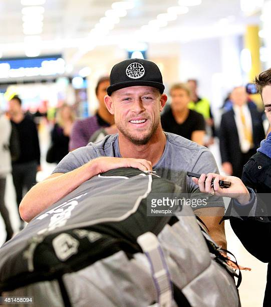 Australian professional surfer Mick Fanning arrives back in Sydney New South Wales after he was attacked by a shark while competing in the JBay Open...
