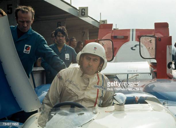 Australian racing driver Jack Brabham pictured positioning himself in the driver's seat of the Equipe MatraSimca MatraSimca MS650 Matra 30L V12 prior...