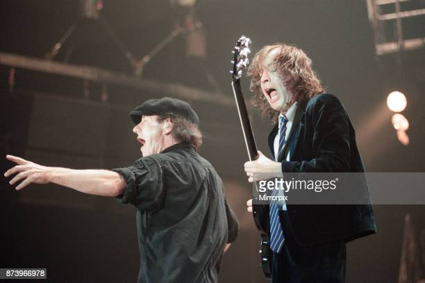 Australian rock group AC/DC performing in concert at the Newcastle Arena during their 'Ballbreaker' World tour Singer Brian Johnson with guitarist...