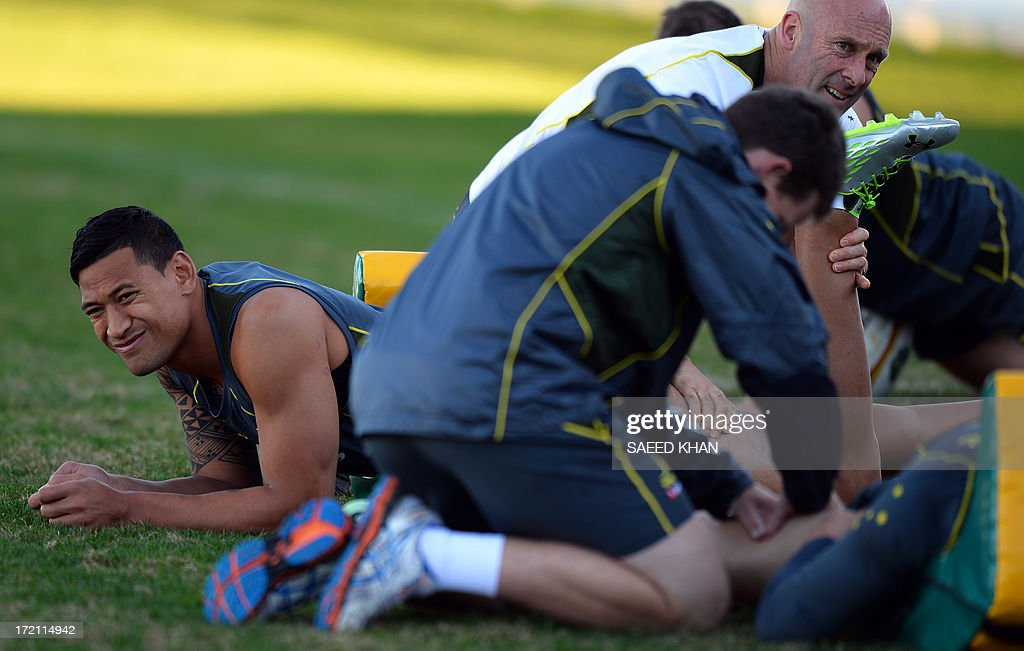 Australian rugby team player Israel Folau gets a leg massage during a training session in Sydney on July 2, 2013. The Australian Wallabies will face the British and Irish Lions in the third and deciding test on July 6 in Sydney. IMAGE STRICTLY RESTRICTED TO EDITORIAL USE - STRICTLY NO COMMERCIAL USE AFP PHOTO / Saeed Khan