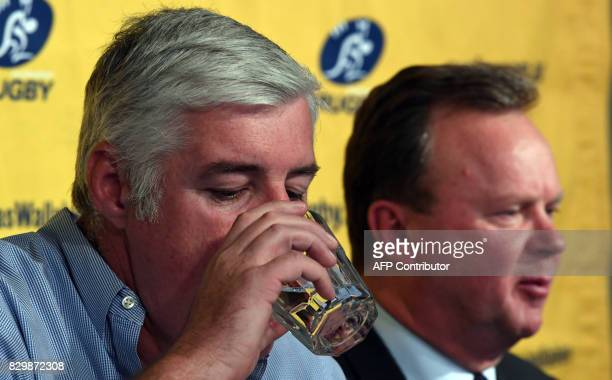 Australian Rugby Union chairman Cameron Clyne drinks water as Bill Pulver CEO of the ARU answers a question at a press conference at ARU headquarters...