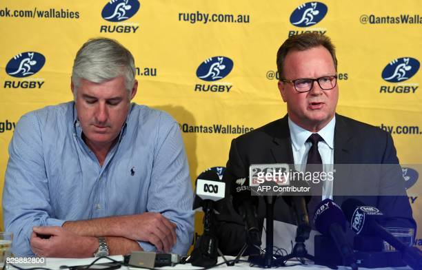 Australian Rugby Union chairman Cameron Clyne listens as Bill Pulver CEO of the ARU speaks during a press conference at ARU headquarters in Sydney on...