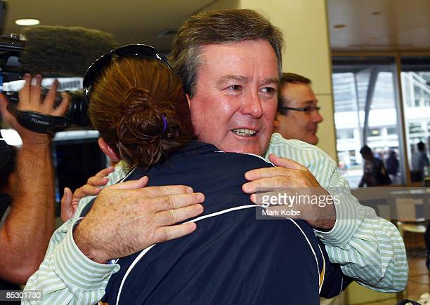 Australian Rugby Union chief executive John O�Neill embraces a member of the victorious Australian women's sevens team after her arrival at Sydney...