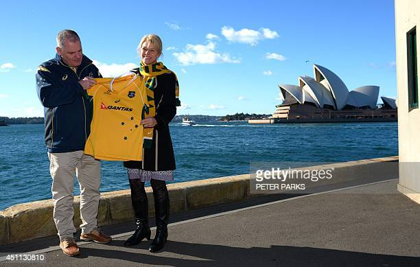 Australian rugby union coach Ewen McKenzie presents Katrina Hodgkinson NSW Assistant Minister for Tourism and Major Events with a Wallabies jersey to...