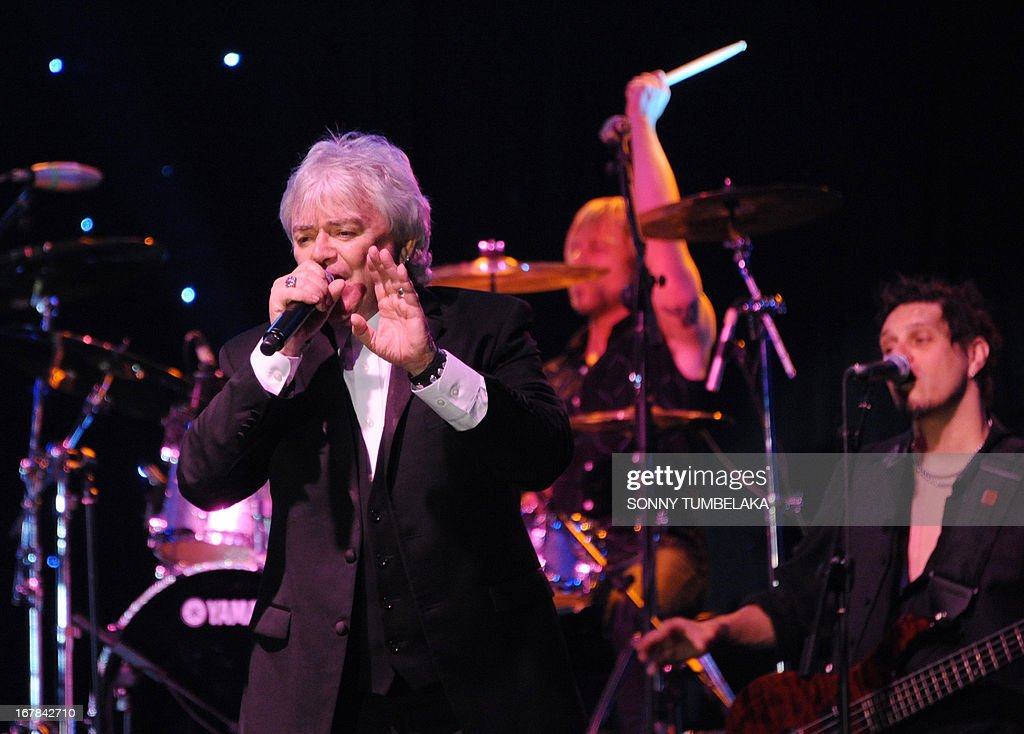 Australian Russell Hitchcock (L), vocalist for Australian-British music duo Air Supply, performs onstage during their 2013 World Tour in Kuta, Indonesia's resort island of Bali, on May 1, 2013.