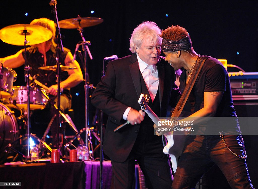 Australian Russell Hitchcock (C), vocalist for Australian-British music duo Air Supply, performs onstage during their 2013 World Tour in Kuta, Indonesia's resort island of Bali, on May 1, 2013. AFP PHOTO/SONNY TUMBELAKA