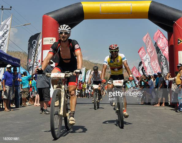 Australian Russell Noble passes the finishing line in Dili on September 15 2012 This year is the fourth Tour de Timor but the first time the sixday...