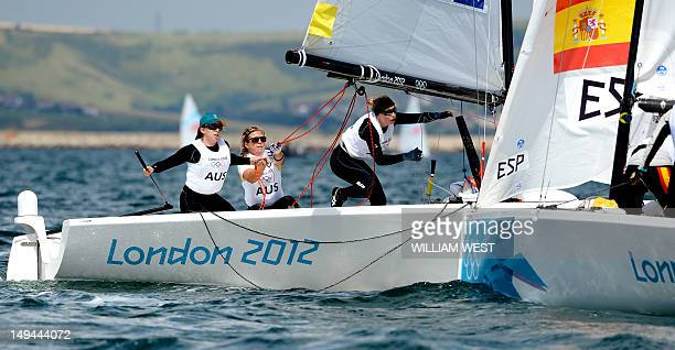 Australian sailors Olivia Price Nina Curtis and Lucinda Whitty watch as their Spanish competitors approach during a practice race in the Elliott...