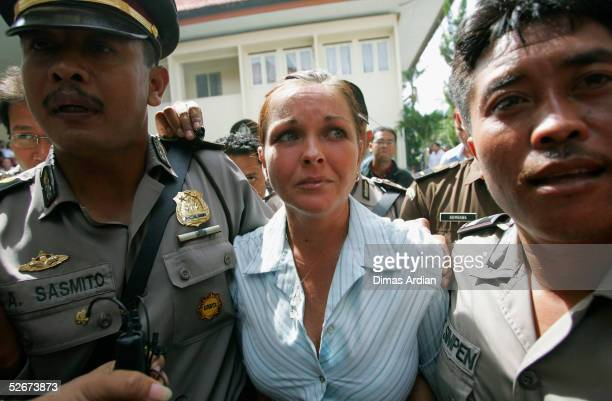Australian Schapelle Corby is escorted by Indonesian Police into a Denpasar courtroom to hear the prosecutor's sentence demands on April 21 2005 in...