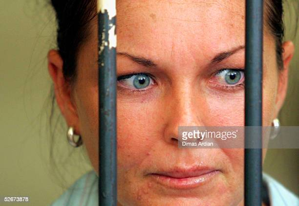 Australian Schapelle Corby talks to her lawyer from behind bars in a Denpasar courtroom just before her trial on April 21 2005 in Denpasar on the...