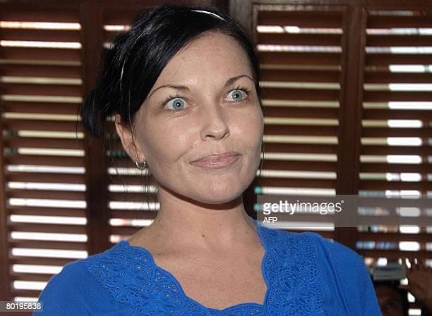 Australian Schapelle Corby talks to woman prisoner inside Kerobokan prison during a press visit in Denpasar on March 11 2008 Corby was sentenced to...