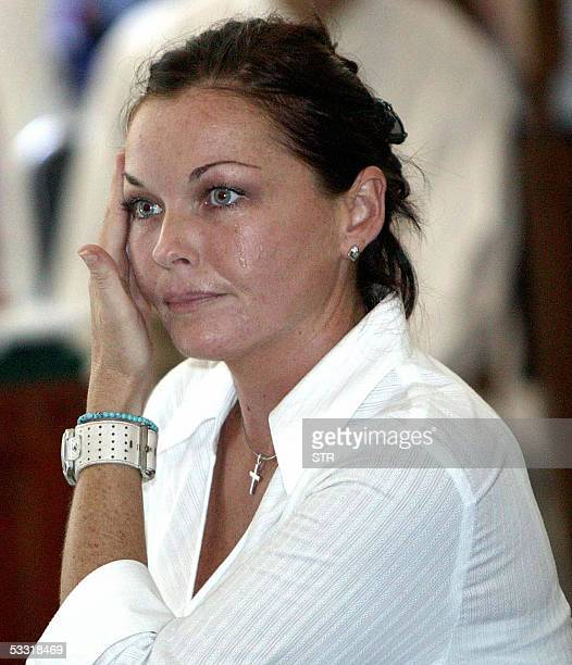 Australian Schapelle Corby wipes her tears during her trial in Denpasar 03 August 2005 Corby has been in jail since October when she arrived on the...