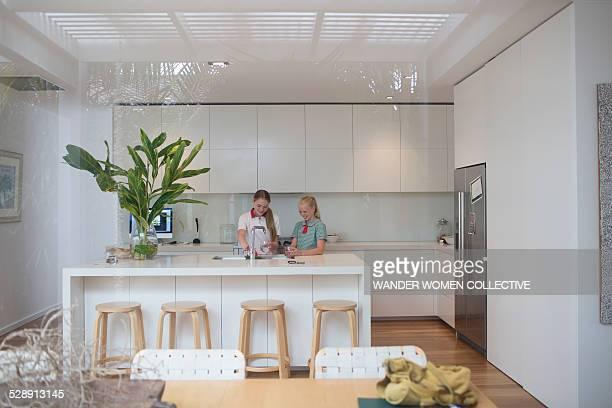 Australian school girls in kitchen at home