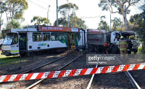 Australian security forces and policemen take security measures at the scene of a tramtruck collision in Parkville district of Melbourne Australia on...