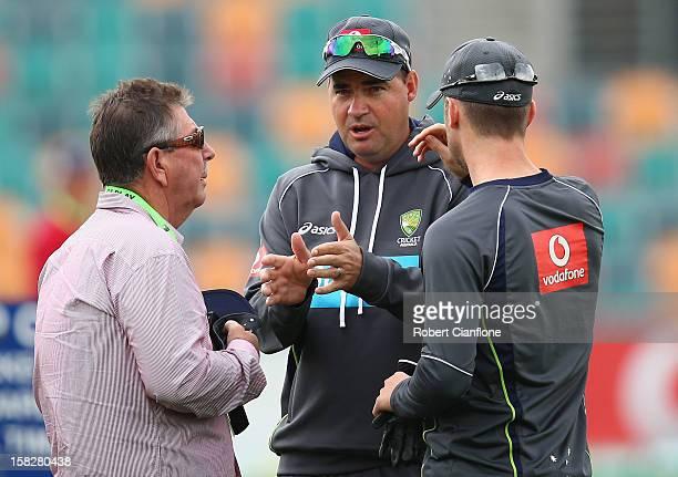 Australian selector Rod Marsh talks with Australian coach Mickey Arthur and captain Michael Clarke during an Australian nets session at Blundstone...