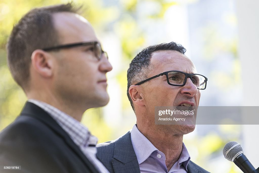 Australian senator and greens leader Richard Di Natale delivers a speech as Adam Bandt standing next to him during a protest demanding that asylum seekers held in off shore detention be brought to Australia at a rally in Melbourne, Australia April on 30, 2016. Protests have started after The Papua New Guinean Supreme Court ruled that the Australian-run detention centres on Manus Island were illegal and unconstitutional.