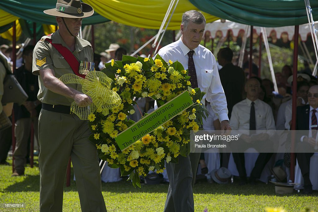 Australian Senator John Hogg (right) prepares to lay a wreath during the Wreath Laying Ceremony at the Kanchanaburi War Cemetery April 25, 2013 in Kanchanaburi, Thailand. Hellfire Pass is a small section of the Burma-Thailand railway which was built by POW's and Asian Laborers under horrific conditions during the Second World War (WWII). Heavy loss of life was suffered during construction due to disease, starvation and exhaustion.