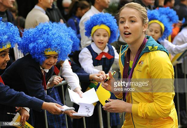 Australian silver medal winning diver Brittany Broben signs autographs as the Australian Olympic team was officially welcomed home with a colourful...