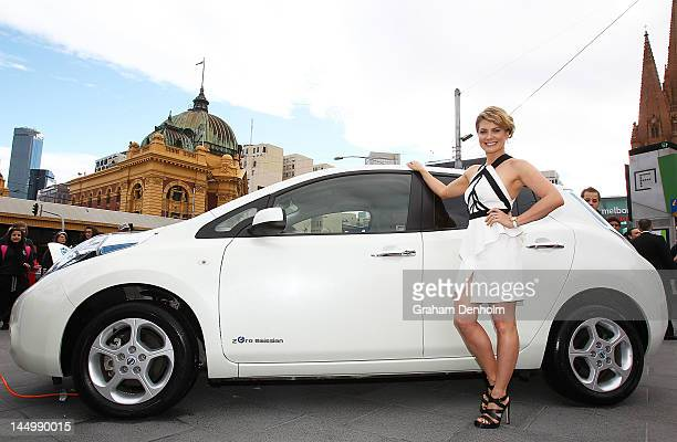 Australian singer and Nissan LEAF ambassador Natalie Bassingthwaighte poses with the Nissan LEAF at Federation Square on May 22 2012 in Melbourne...