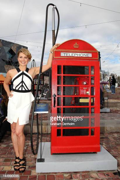 Australian singer and Nissan LEAF ambassador Natalie Bassingthwaighte poses with a recycled petrol bowser at Federation Square on May 22 2012 in...