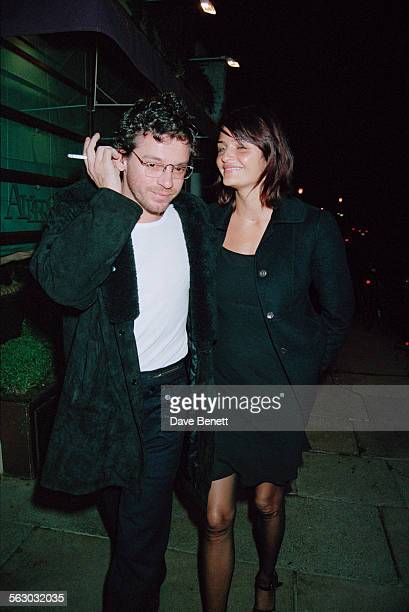 Australian singer and songwriter Michael Hutchence and Danish fashion model Helena Christensen leaving the San Lorenzo restaurant London 22nd...