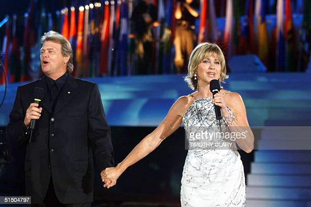 Australian singer Olivia NewtonJohn wearing diamonds to the value of 16 million dollars and John Farnham sing 'Dare to Dream' before the assembled...
