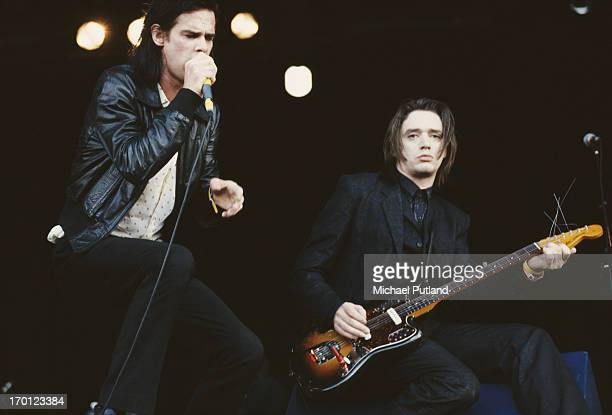 Australian singersongwriter Nick Cave and German guitarist Blixa Bargeld performing with Nick Cave and the Bad Seeds on the Other Stage at the...