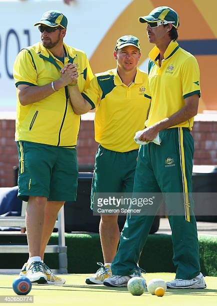 Australian skip Matt Flapper celebrates winning a game with team mates Wayne Ruediger and Nathan Rice of Australia during the Men's Triples at...