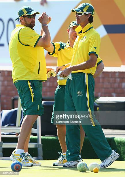 Australian skip Matt Flapper celebrates winning a game with team mates Wayne Ruediger and Nathan Rice of Australia during the Men's Triples at...