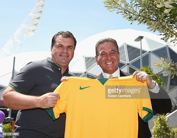 Australian Socceroos Coach Ange Postecoglou prsents a Socceroo jersey to the Victorian Minister for Tourism and Major Events John Eren at Melbourne...