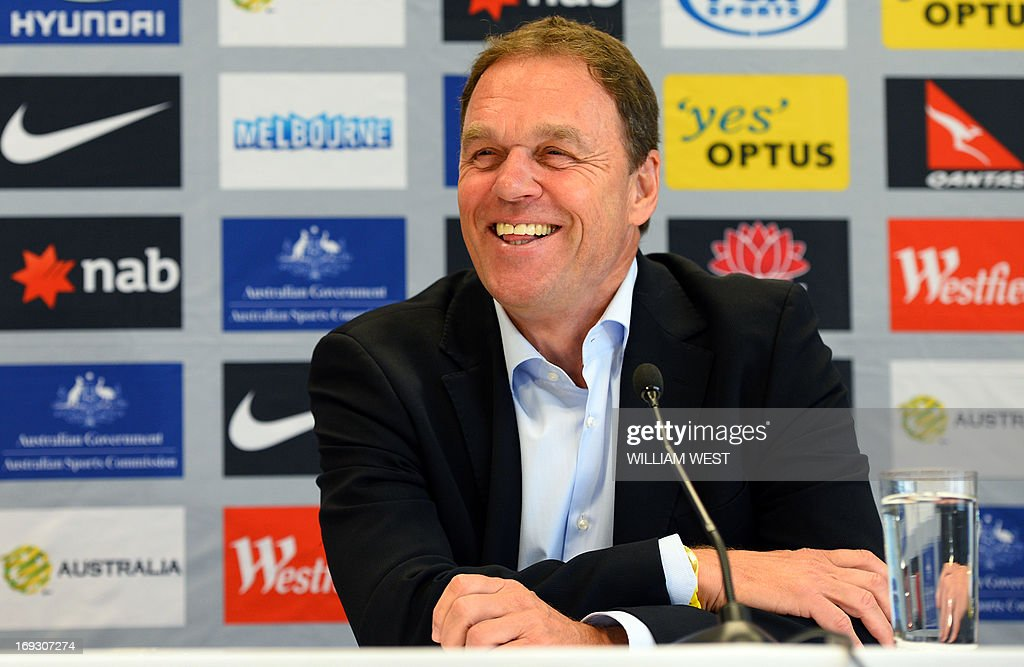 Australian Socceroos football coach Holger Osieck speaks at a press conference after announcing the team for next month's three decisive Asian World Cup qualifiers against Japan, Jordan and Iraq, in Sydney on May 23, 2013. Experienced defenders, skipper Lucas Neill and Sasa Ognenovski, were named in a 26-man squad by coach Holger Osieck as Australia bid for a top two place in Group B and automatic qualification for next year's World Cup in Brazil. AFP PHOTO/William WEST