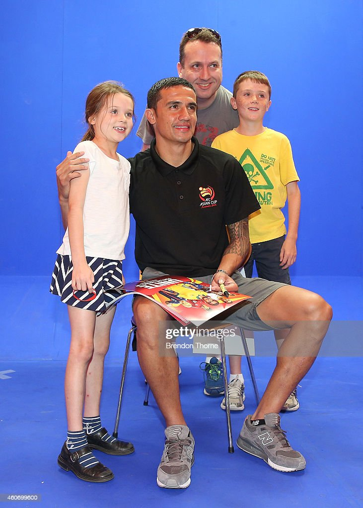 Australian Socceroos player Tim Cahill poses with fans during the launch of the Football Fan Park at Customs House on December 20, 2014 in Sydney, Australia.