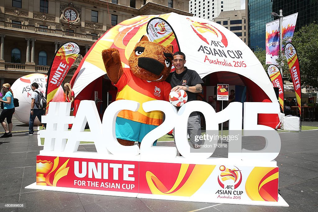 Australian Socceroos player Tim Cahill poses with 'Nutmeg' during the launch of the Football Fan Park at Customs House on December 20, 2014 in Sydney, Australia.
